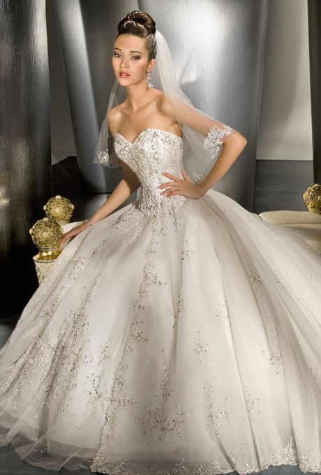 DEMETRIOS - ILISSA   Style No: 984  Sparkling tulle strapless ball gown with split-front skirt and beaded embroidery throughout. Semi-cathedral train