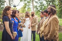 THE WEDDING PARTY : The bridesmaids carried their burlap flower bouquets and wore any style blue dress they wished and the groomsmen wore jeans, plaid shirts with tweed jackets and a burlap flower on their lapels.