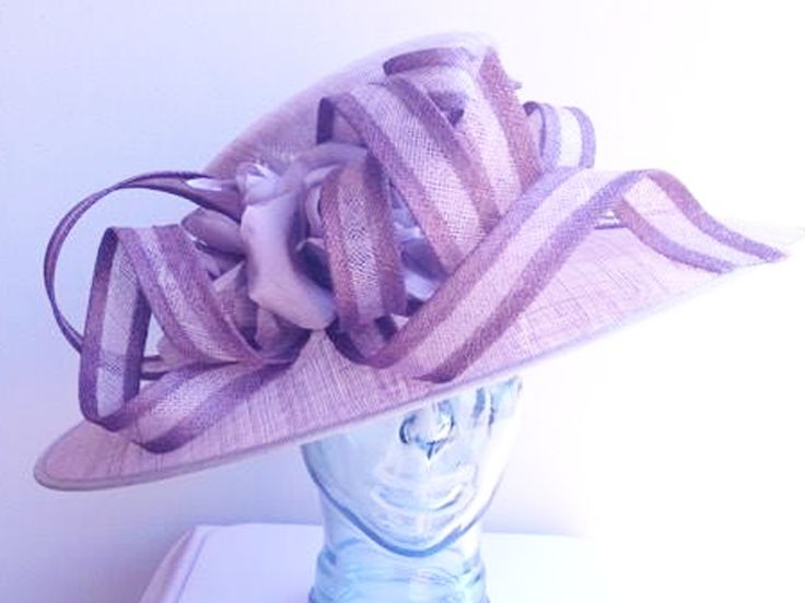 Quartz and Iris Hat 1839 to buy online or in store at Hadleigh Hats in Hadleigh, Essex.    iris, quartz, large, oval brim, tall angled crown, ribbons, waves, loops, curls, silk, flower, wedding, ascot, occasion, races, ladies day, mother of the bride, mother of the groom hat