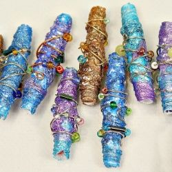 Make beautiful metallic beads with recycled Tyvek envelopes from the post office.