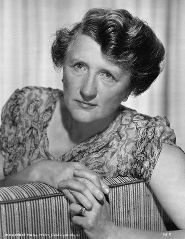 """Marjorie Main (1890-1975).  American character actress, mainly at MGM, perhaps best known for her role as Ma Kettle in a series of ten Ma and Pa Kettle movies. And that voice--raspy and completely unforgettable! Born Mary Tomlinson, she adopted a stage name to avoid embarrassing her father, Samuel J. Tomlinson, who was a minister. She worked in vaudeville and debuted on Broadway in 1916. Her first film was """"A House Divided"""" in 1931. (Source: Wikipedia)"""