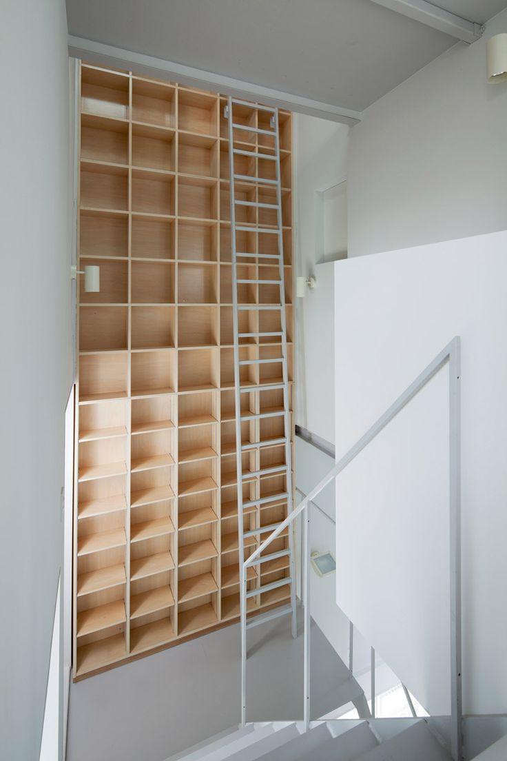 tall bookcase with library ladder.  ryuji fujimura architects: storage house