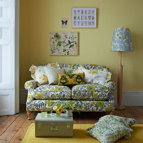 Yellow country-style living room with floral sofa