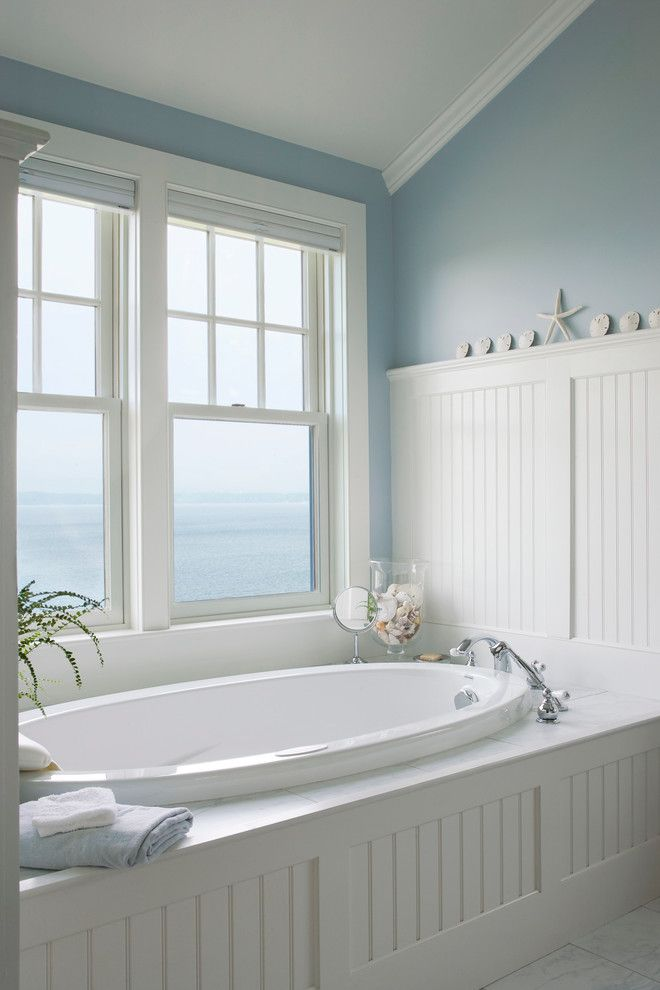 Chic United Home Builders Cape Coral technique Burlington Beach Style Bathroom Decorating ideas with dreamy light blue walls seashells starfish three wall alcove wainscoting waterfront