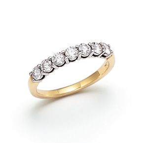 Need to add the perfect wedding ring to that wonderful 2 tone gold vintage engagement ring you're wearing and loving now? Take a look at this Tiffany's traditional, vintage style, shared prong diamond band. Total of 0.56cttw between 7 stones, giving a nice presence on the hand with 8 point stones, as part of a wedding set, or even alone. Band ring. Diamonds, 18k gold.