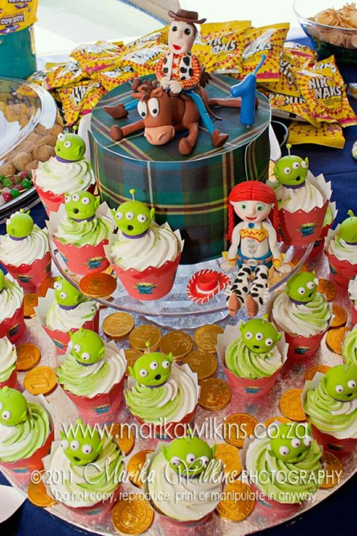 Toy story themed cake and cupcakes. Woody, Jessie, Bullseye and the Aliens