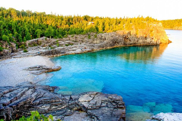 Bruce Peninsula National Park, Ontario, Canada — by Ai Long. Every hiker along the Bruce Trail and every camper at Cyprus Lake Camp Ground will be rewarded with the panoramic...