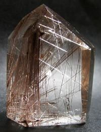 Rutilated Quartz: Many different minerals can form as inclusions within quartz. One of the most important varieties of included quartz for gem use is rutilated quartz. Rutilated quartz usually occurs as rutilated rock crystal, rutilated smoky quartz or rutilated milky quartz.  Rutilated quartz forms in quartz veins, usually with milky quartz bordering the vein with quartz crystals growing in toward the center, growing around and enveloping the rutile crystals traversing the vein.  Natural…