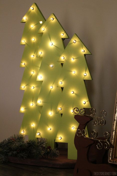 DIY Wooden Trees with Lights, marquee style. Perfect for indoor or outdoor Christmas decor and they add a nice touch to your home's Rustic themed Christmas! Great DIY Christmas craft idea! These wooden trees were painted with BEHR paint in Pistachio.