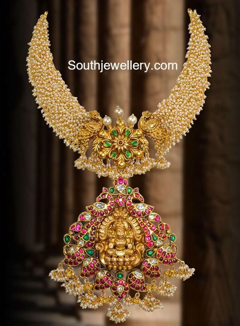 22 carat gold antique finish unique pearls necklace featuring Goddess Lakshmi pendant surrounded by peacocks and mangoes and adorned with small basara pearls, rubies, emeralds and polkis. For inquiries contact: Swarnsri Gold and Diamonds, Vijayawada, Whatsapp number : 9393891000 Related PostsPearls Necklace with Lakshmi PendantSwan Design Guttapusalu Necklace and EarringsBlack Thread Guttapusalu NecklaceAntique Pearls ChokerKundan Peacock …