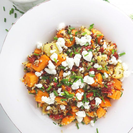A healthy salad with quinoa, roasted sweet potatoes and cauliflower, creamy goat cheese and tangy sun dried tomatoes. So much flavor!