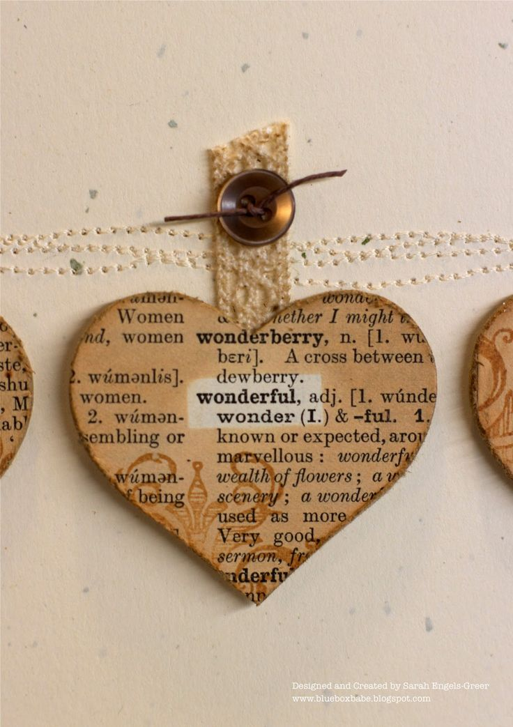 "Dictionary hearts Cards. ""I covered card stock in dictionary pages and die cut three hearts making sure I 'caught' certain words. I placed a little scrap over the word, inked up the rest of the heart and added some stamping before distressing the edges."" Great for an embelishment"