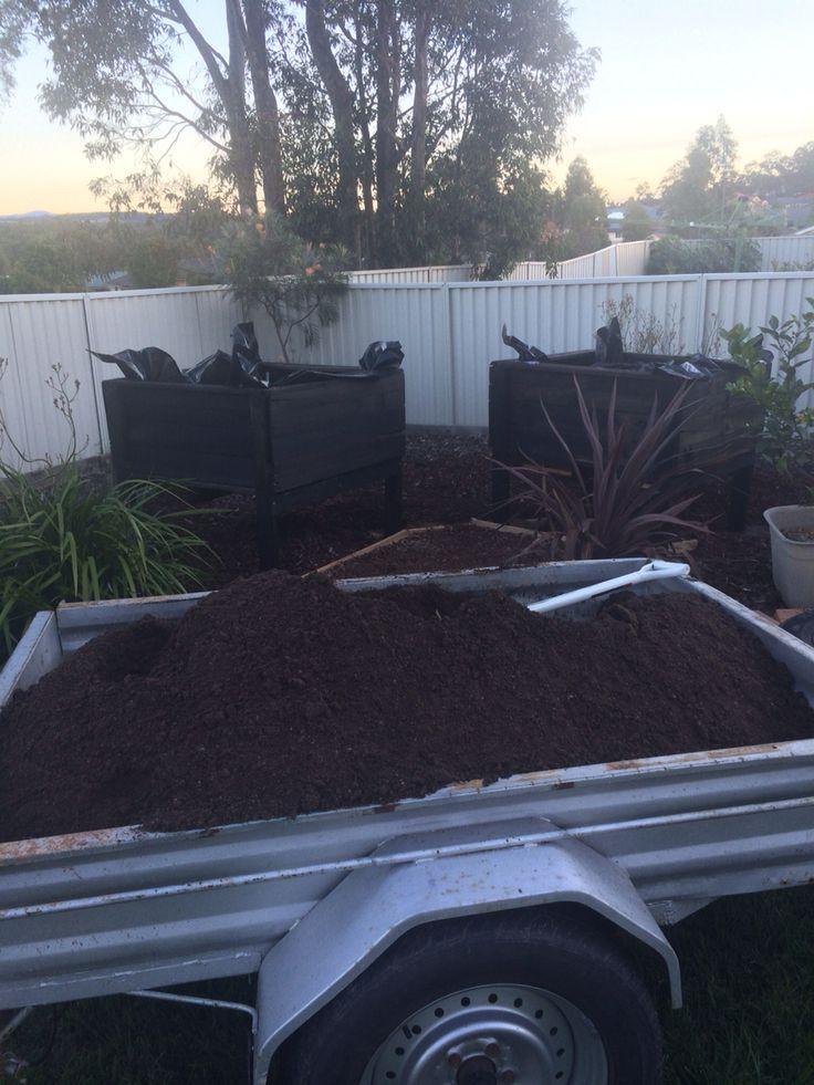 Filling self watering garden beds