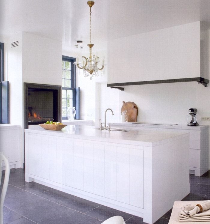 All in white kitchen. Did you notice the painted windows and shutters? And again a remarkable kitchen hood.