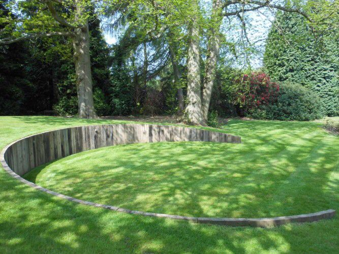 Retaining structure to create level lawn area