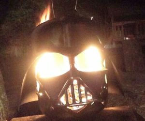 Darth Vader Helmet Fire Pit . Experience the blazing fury of the Dark Side using this Darth Vader helmet fire pit. Upon being lit, the Da...