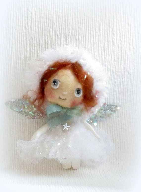 Baby cloth doll Angel Fairy by suziehayward on Etsy, $58.00 - This littlun is aprox four inches with wired arms .She has aqua eyes and auburn mohair hair covered with a furry bonnet .Her skirt is crushed tulle .The wings are embellished with glitter . Great for a Christmas tree gift Not suitable for young children