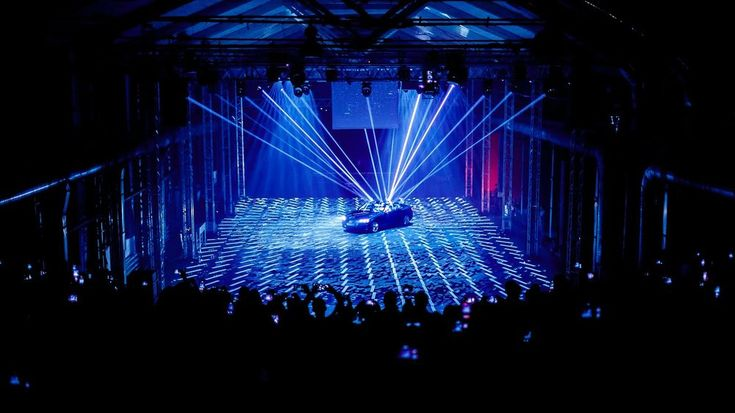 """The new Audi A5 Coupé premiere became the world's first automobile launch event employing real-time motion tracking technology. The car's advantages were presented in an innovative show """"Artificial Intelligence vs YOU' — the result of a creative collaboration between the event's general produc"""
