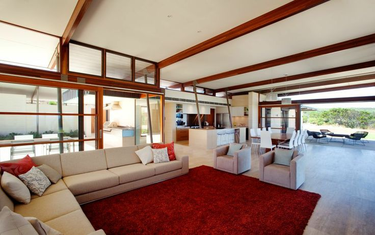 Stunning View From A Modern Minimalist House:large-living-room-with-big-sofa-cushion-and red-furry-rug-and-big-sliding-glass