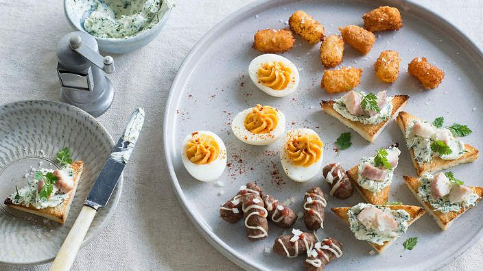 These Dutch stuffed eggs are a perfect party starter. Serve with tiny hot dogs, croquettes and eel toasts. Listen to the audio recipe.