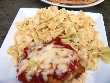 Jack Astors - Chicken Parmigiana: Fresh chicken breast, lightly breaded and topped with smoked Mozzarella cheese and tomato sauce. Served with bowtie pasta, tossed in a creamy cheese sauce.