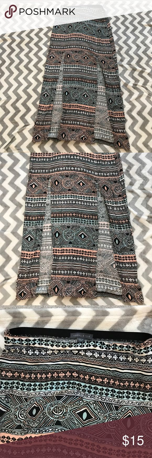 Kendall and Kylie tribal slit front maxi skirt Tribal maxi skirt with 2 front slits to show off your legs, flat front with elastic back waistband colors: peach, white, black, and aqua Kendall & Kylie Skirts Maxi