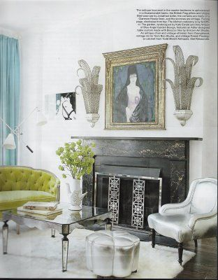 I would have taken this area for her formal living room! I adore the vintage loveseat (upholstered in a Scalamandre fabric) and the vintage sconces are pretty eye catching also.