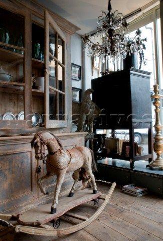 JST001_03: Antique shop interior with wooden rocking ho - Narratives Photo Agency