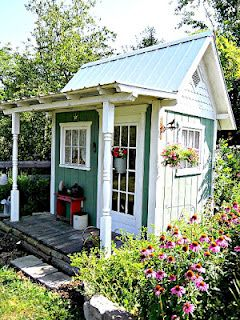 Gorgeous shed with a porch! How cool is that?