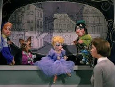 That's Carrot Top, Reynardo the Wolf, vain ballerina Marguerite, and gentle giant Golo -- the equivalents of Kukla, Oliver J. Dragon, opera diva Madame Oglepuss, and her blustering gentleman friend Col. Crackie. And Lili, of course, played by Leslie Caron standing in for Fran Allison.  And lest you think the connection simply ends there, here are the puppets in the movie, Lili.  Compare them almost spot-on to the Kuklapolitans.