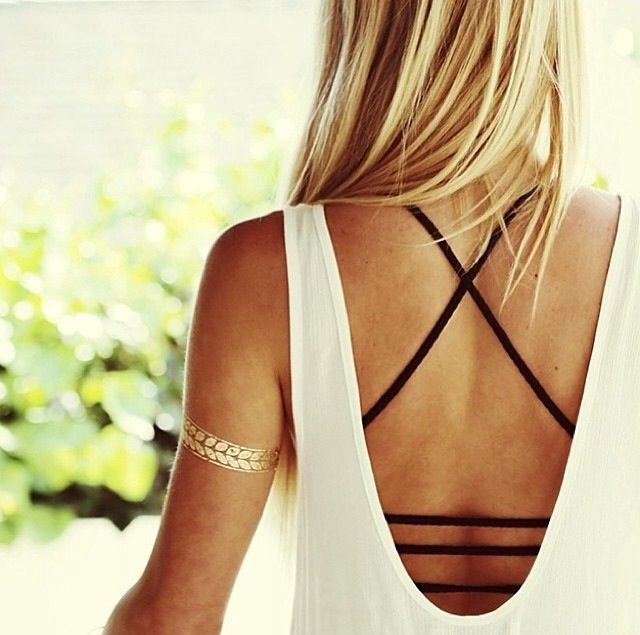 """Wear a strappy """"bra-top"""" under backless tops and other tops you don't wanna wear a regular bra under."""