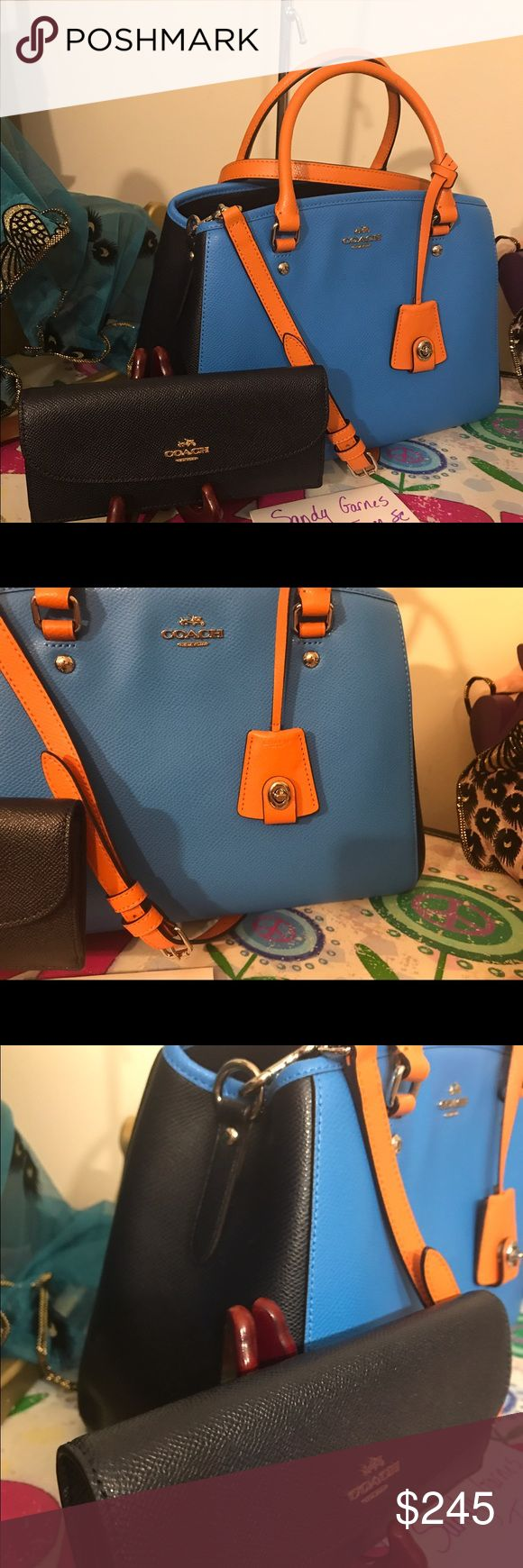 """Nwt Coach Margot color-block set No trades or holds. Price is firm.  NWT Coach Margot Leather Color-block set. Colors are orange, turquoise  and midnight. Wallet is nwt and is in midnight leather. Purse measures 13"""" across bottom, 11"""" across bottom, 9.5"""" tall, double leather handles with a 9"""" drop and a cross body strap with up to a 23"""" strap drop. Coach Bags Satchels"""