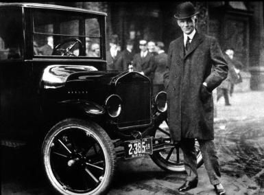 """""""I Will Build a Car for the Great Multitude"""": The Henry Ford Story: Hanry Ford in front of a Model T"""