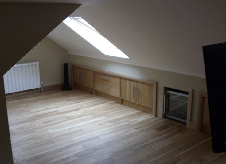 Small loft conversion with built-in eaves storage