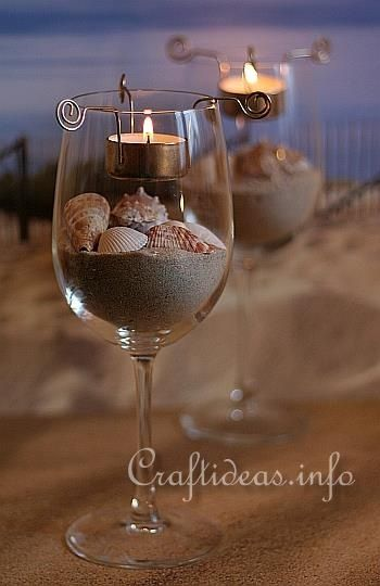 For this project you will need:    - large wine glasses  - tea light inserts  - tea lights  - sand  - seashells  1. First fill the glass about 1/4 full with sand.  2. Arrange the seashells onto the sand as you please.  3. Place the tea light in the insert and then hang on to the glass rim. elizabeth82081