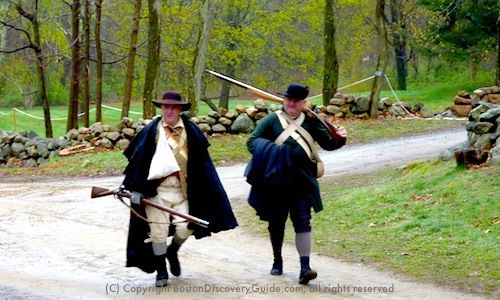Colonial militia during Patriots' Day reenactment at Minute Man National Historic Park near Boston