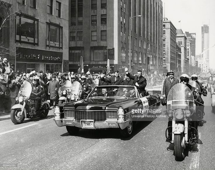 Astronauts Virgil 'Gus' Grissom and John Young Being Greeted by Crowd During Parade on Michigan Avenue after Completion of Gemini 3 Space Mission, Chicago, Illinois, USA, March 30, 1965.