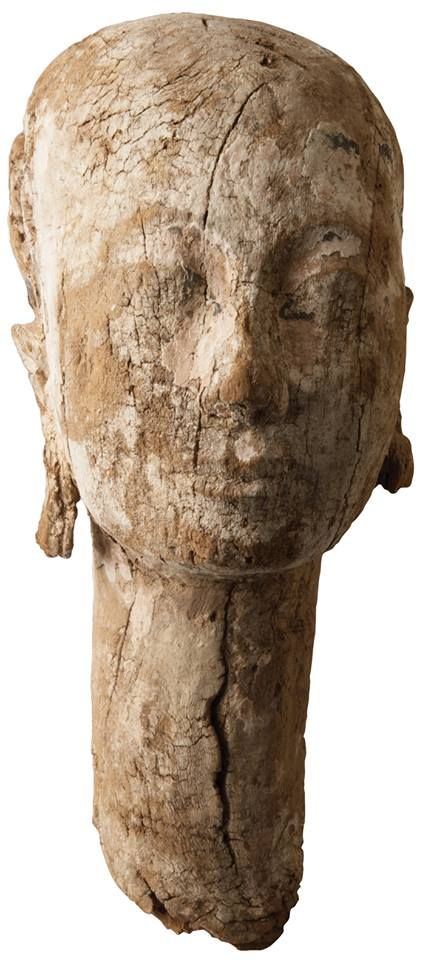 A wooden statue head found in the funerary area of Ankhnespepy II, a queen of Egypt's Old Kingdom, appears to date to the later New Kingdom, which is puzzling to archaeologists as there are no wealthy graves from that period in the area. -Archaeology.com