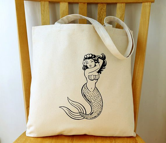 "Mermaid Canvas Tote Bag Beach Bag Gift for Women  A sassy mermaid friend just for you! This girl is comfortable in her own fins and ready for your next adventure.  Measuring 15"" x 14 1/2"" x 1"", this roomy 8 oz. canvas tote bag is great for carrying beach gear, books, groceries, or almost anything else you need during the day.  The image was screen printed by me using non-toxic, water based ink. Because of the screen printing process, there will be slight differences from bag to bag. Each..."