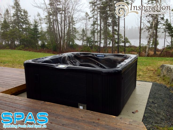 Gorgeous view behind this Canadian-made hot tub in Halifax, Nova Scotia Canada. This is an S105 Hot Tub (Inspiration line) by Sunrise Spas. They will be wrapping the decking right around the tub. Beautiful. www.sparklingpoolsandspas.ca