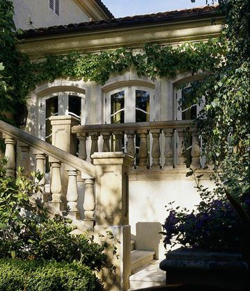 Country French Curb Appeal        With its limestone-and-stucco exterior, terra-cotta tile roof, and immaculately clipped parterre gardens, this home begins its French dialogue at the curb. The home resembles a 19th-century French villa.