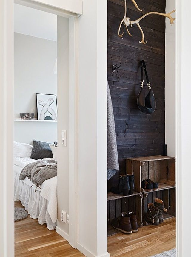 reclaimed wood plank wall and crates in mud room