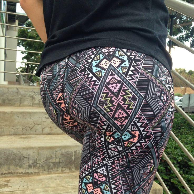 Fitness fashion. Colourful geometric gym tights.