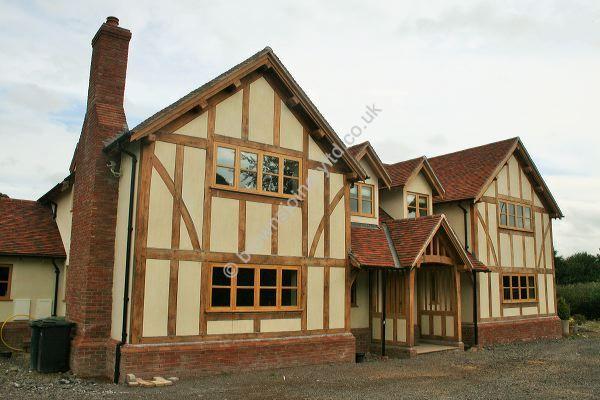 Border Oak style Porch with New Oak Windows and Doors by www.brownsjoineryltd.co.uk