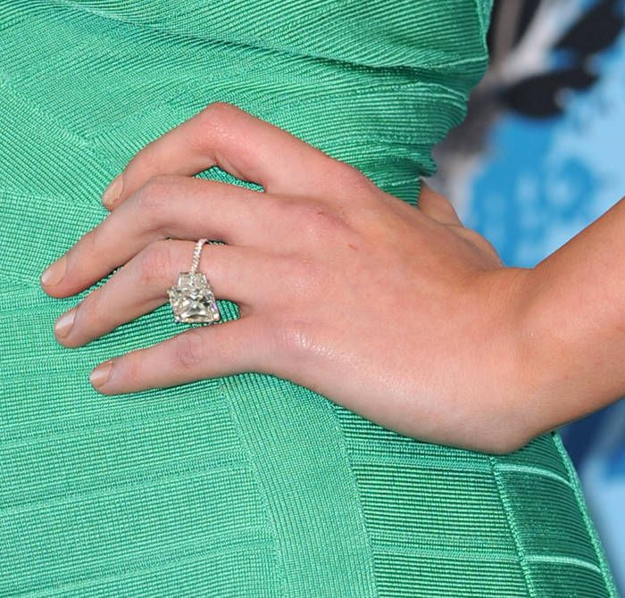 "Gorgeous ring but this is the problem with a large stone -- the ring can droop, and drooping is not chic. A thicker band can offset the weight a little better, but I hate thicker bands. (Sure would be an amazing commentary on my life, though, if if receiving an engagement ring this ginormous was actually a ""problematic possibility"" !)"