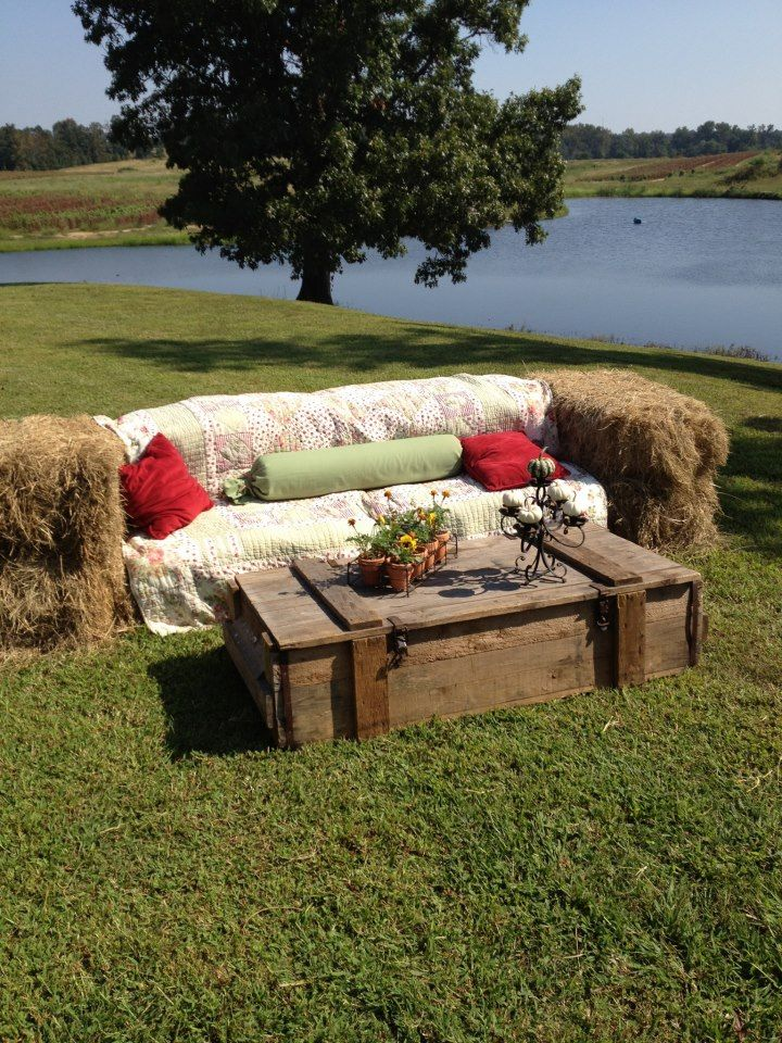 Hay bale sofa and coffee table. You can use fabric and pillows to accent your (wedding) colors and theme - at Red Barn Ranch barn wedding venue in San Diego - (Fire ants LOVE hay bales!  Do not place the bales out until day of party. If you want to use the bales to feed livestock afterwards, do not leave in fields. /B.)