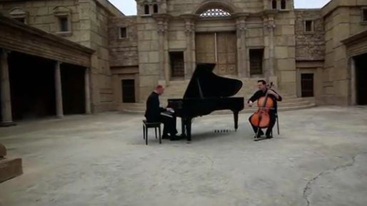 "The famous Piano Guys play another beloved carol. This time it's a very moving rendition of ""O Come, Emmanuel"" shot on a movie set that looks just like Old Jerusalem!"
