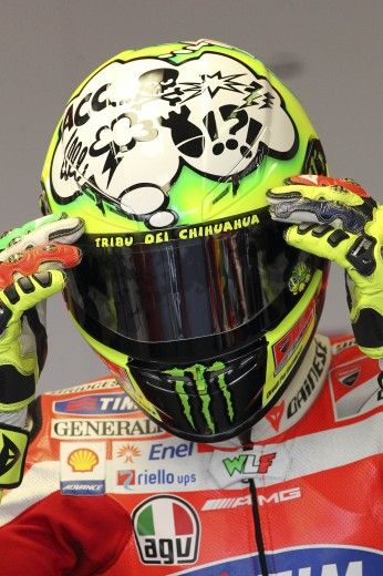 Valentino Rossi, Note the WLF on his leathers.  Who is the first to explain the story behind this?