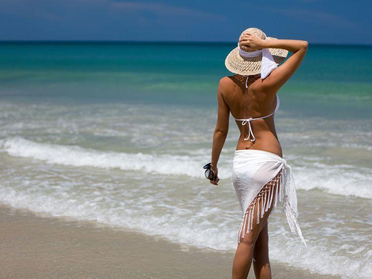 http://www.wallpapersxl.com/wallpapers/1024x768/beach-women/217785/beach-women-beautiful-beaches-hat-lady-model-nature-people-beautifull-217785.jpg