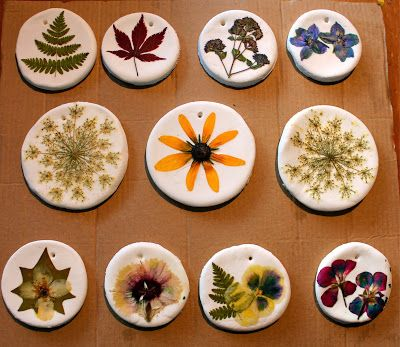 pressed flower ornaments - Dough is made from 1 cup baking soda, 1/2 cup corn starch, 3/4 cup of warm water. Roll flat, cut out circles, punch hanging holes, and bake at 200 degrees F for an hour. Mod podge pressed flowers onto bases and hang.